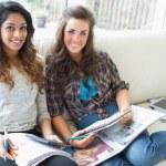 Smiling girls checking a calculator — Stock Photo #23090854