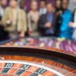 Standing looking at the roulette wheel — Stock Photo #23091168