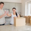 Two young celebrating their move — Stock Photo #23091200