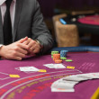 Man sitting at poker table with cards and chips — Stock Photo #23091408