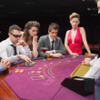 Sitting at table playing poker — 图库照片