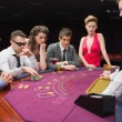 Sitting at table playing poker — Foto Stock