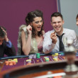 Winner and loser at roulette table - Stock Photo