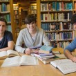 Students looking up from studying — Stock Photo