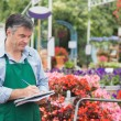 Florist taking notes — Stock Photo