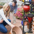 Couple looking at ceramic plant pot — Stock Photo #23092342