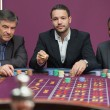 Three men playing roulette — Stock Photo