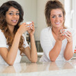 Two smiling women having coffee — Stock Photo