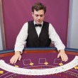 Стоковое фото: Dealer with fanned out deck of cards