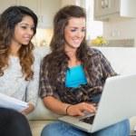 Two happy girls doing homework — Stock Photo #23093720