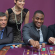 Bets being placed at roulette table - Stock Photo