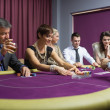 People sitting playing poker - Stock Photo