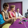 Sitting at poker table — Stock Photo #23094106