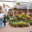 Family standing in the garden center — Stock Photo
