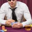 Man in sunglasses playing poker — Stock Photo