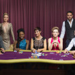 Well-dressed group at poker table — Stock Photo