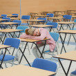 Stock Photo: Student napping in exam hall