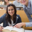 Smiling student and lecturer with book — Stock Photo #23098326