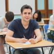 Man looking up from exam and smiling — Stock Photo