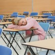 Woman napping in exam hall — Stock Photo