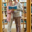 Couple standing at library — Stock Photo #23098828