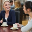 Women sitting at the coffee shop chatting — Stock Photo #23098850