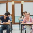 Students in an exam while one is thinking — Stock Photo