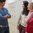 Stock Photo: Friends talking in college hallway