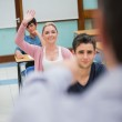 Woman asking question in class — Stock Photo
