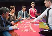 Four playing poker — Stock Photo