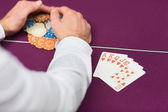 Man winning at poker with royal flush — Stock Photo
