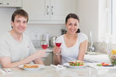 Young couple enjoying their meal — Stock Photo