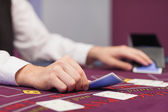 Dealer distributing cards in a casino — Stock Photo