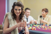Woman with champagne smiling — Stock Photo