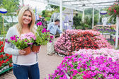 Female customer in garden center — Stock Photo
