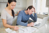 Young couple calculating finances — Stock Photo