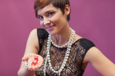 Woman in casino holding dices — Stock Photo