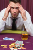 Man losing his house at poker game — Stock Photo
