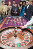 Standing at the roulette — Stock Photo