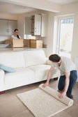 Young furnishing the house — Stock Photo
