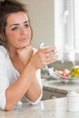 Thinking woman having coffee — Stock Photo