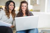 Happy friends using laptop — Stock Photo