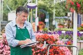 Florist taking notes — Stock Photo