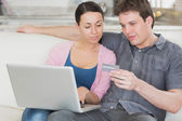Young couple working on the laptop — Stock Photo