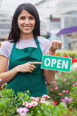Woman holding an open sign — Stock Photo