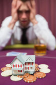 Man risking his house at poker game — Stock Photo