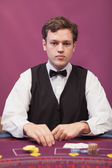 Dealer at table of a casino — Stock Photo