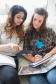 Girls checking a calculator — Stock Photo