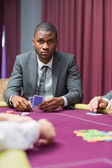 Man looking up from poker — Stock Photo