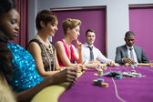 Sitting at poker table — Stock Photo